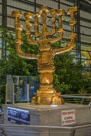 proficiency: TEL AVIV, ISRAEL - FEBRUARY 26, 2014: Menorah sculpture made by Salvador Dali in front of the main entrance to the international airport Ben Gurion.