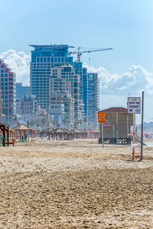 TEL AVIV, ISRAEL - MARCH 1, 2014: Panorama of the beach, riviera, hotels and long promenade along skyline shot from the beach.