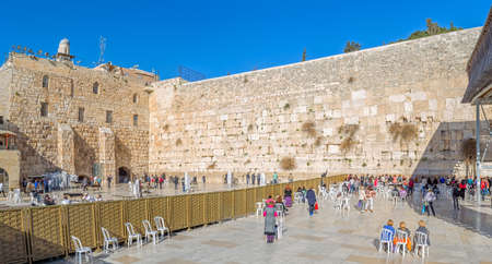 kotel: JERUSALEM, ISRAEL - FEBRUARY 28, 2014: Tourists and prayers visiting and making their wishes at The Western Wall, Wailing Wall or Kotel witch is located in the Old City at the foot of the western side of the Temple Mount.