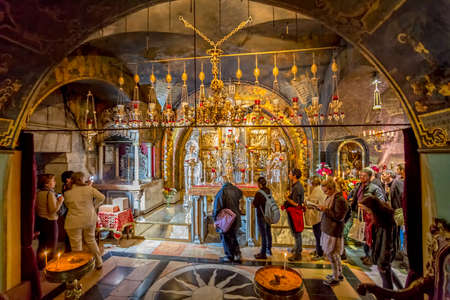 sepulcher: JERUSALEM, ISRAEL - FEBRUARY 28, 2014: People make pilgrimages to the Altar of the Crucifixion in Church of the Holy Sepulchre.