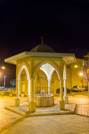 The promenade in the center of Jaffa with covered and recently renovated well. Stock Photo - 27495650