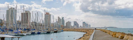 TEL AVIV, ISRAEL - MARCH 1, 2014: View of the marina, riviera and promenade along skyline from the marina breakwater
