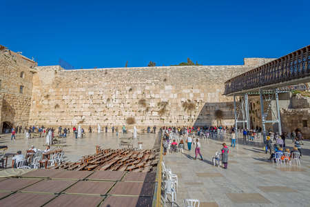 JERUSALEM, ISRAEL - FEBRUARY 28, 2014: Tourists and prayers visiting and making their wishes at The Western Wall, Wailing Wall or Kotel witch is located in the Old City at the foot of the western side of the Temple Mount.