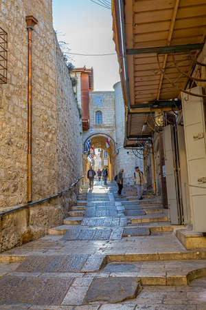 JERUSALEM, ISRAEL - FEBRUARY 28, 2014: People sightseeing old narrow streets in the Old City near Jaffa gate.