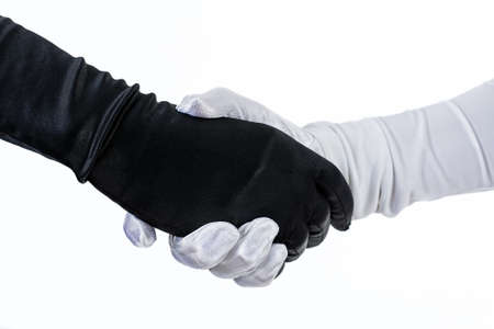 Theatrical costumed handshake. Fancy black and white gloves isolated.