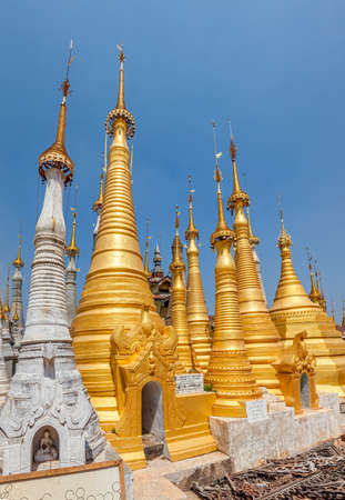 turistic: INDEIN, MYANMAR - FEBRUARY 28, 2013: Renovated ancient Stupas great turistic attraction, Inle lake. Editorial