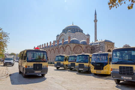ISTANBUL, TURKEY - SEPTEMBER 28, 2013: City buses parked on the turnpike near the Mihrimah Sultan Mosque in Istanbul.