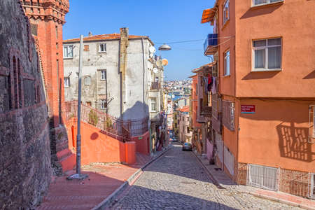 constantinople: ISTANBUL, TURKEY - SEPTEMBER 28, 2013: Street with old traditional houses and filigree sidewalk in Phanar district inside the walls of Constantinople.