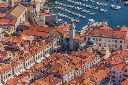 Aerial helicopter shoot of Dubrovnik old town with a view to the main street Stradun (Placa). photo