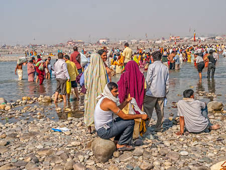bathers: HARIDWAR, INDIA - APRIL 14, 2010: People performing a religious ritual in the holy river Ganga at the Kumbh Mela, a mass Hindu pilgrimage of faith. Editorial