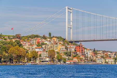 mehmet: ISTANBUL, TURKEY - SEPTEMBER 29, 2013: View of the Fatih Sultan Mehmet Bridge and residental buildings sailing Bosporus. Editorial