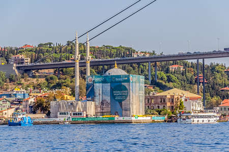 sailling: ISTANBUL, TURKEY - SEPTEMBER 29, 2013: View of the Ortaköy Mosque in restoration and First Bosphorus Bridge, sailling Bosporus.