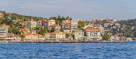 residental: ISTANBUL, TURKEY - SEPTEMBER 29, 2013: View of the Arnavutkoy residental buildings sailing Bosporus.