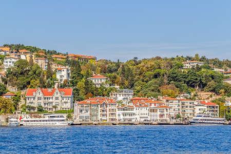 residental: ISTANBUL, TURKEY - SEPTEMBER 29, 2013: View of the Arnavutkoy old wooden residental buildings sailing Bosporus. Editorial