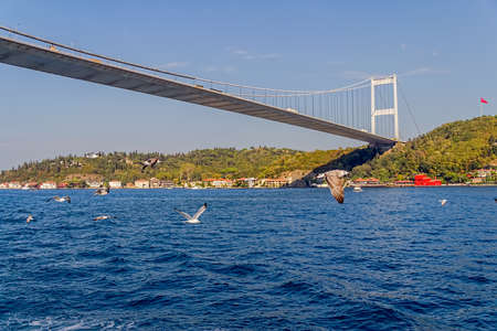 View of the Fatih Sultan Mehmet Bridge and residental buildings on asian side sailing Bosporus. Stock Photo