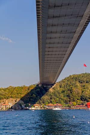 residental: View of the Fatih Sultan Mehmet Bridge and residental buildings on asian side sailing Bosporus. Stock Photo