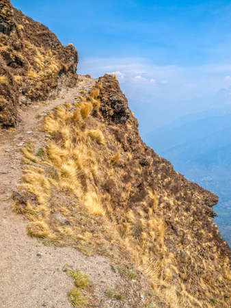 tallness: The narrow trekking path on the dizzy Himalayan heights in India.