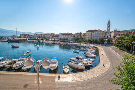 brac: SUPETAR, CROATIA - JULY 24, 2014: Small port with fishing boats in the early morning on Island Brac.