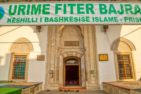 fatih: PRISTINA, KOSOVO - JULY 29, 2014: Entrance to the Fatih Mosque during Eid. Islam is the main religion in Kosovo