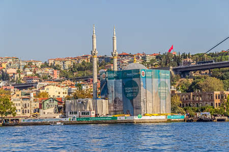 ISTANBUL, TURKEY - SEPTEMBER 29, 2013 View of the Ortakoy Mosque in restoration and First Bosphorus Bridge, sailling Bosporus.