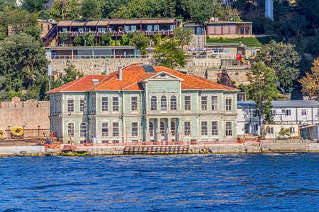 ISTANBUL, TURKEY - SEPTEMBER 29, 2013 View of the Ortakoy district old house by the sea sailling Bosporus. Editorial