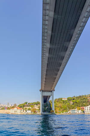 sailling: ISTANBUL, TURKEY - SEPTEMBER 29, 2013 View of the First Bosphorus Bridge sailling Bosporus. Editorial