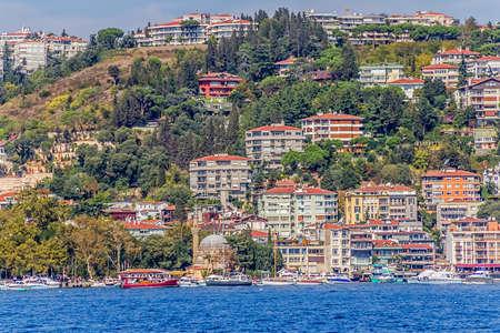residental: ISTANBUL, TURKEY - SEPTEMBER 29, 2013 View of the Bebek residental buildings and Rumelihisari castle historical sailing Bosporus.