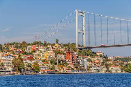 residental: ISTANBUL, TURKEY - SEPTEMBER 29, 2013 View of the Fatih Sultan Mehmet Bridge and residental buildings sailing Bosporus. Editorial