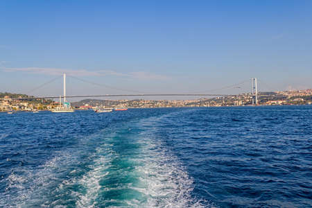 ISTANBUL, TURKEY - SEPTEMBER 29, 2013 View of the First Bosphorus Bridge connecting Europe and Asia, sailling Bosporus.
