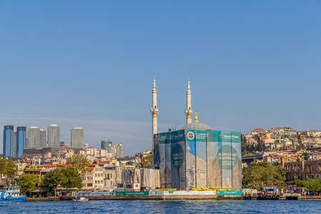 ISTANBUL, TURKEY - SEPTEMBER 29, 2013 View of the Ortakoy Mosque in restoration sailling Bosporus.