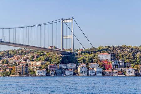 mehmet: ISTANBUL, TURKEY - SEPTEMBER 29, 2013 View of the Fatih Sultan Mehmet Bridge and residental buildings sailing Bosporus. Editorial