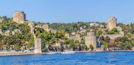 residental: ISTANBUL, TURKEY - SEPTEMBER 29, 2013: View of the Rumelihisari castle sailing Bosporus. Editorial