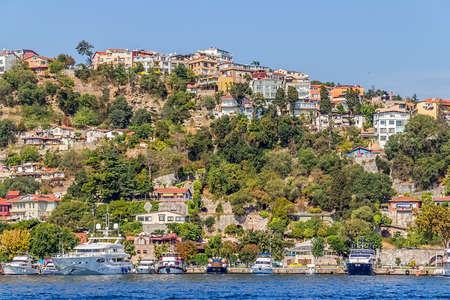 residental: ISTANBUL, TURKEY - SEPTEMBER 29, 2013: View of the Besiktas residental buildings sailing Bosporus.