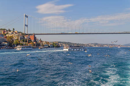 fatih: ISTANBUL, TURKEY - SEPTEMBER 29, 2013: View of the Fatih Sultan Mehmet Bridge and residental buildings sailing Bosporus. Editorial