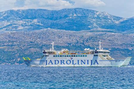 SUPETAR, CROATIA - July 23, 2014 Jadrolinija ferry Hrvat sailing Brac Channel on a summer day. Editorial