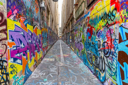 window graffiti: MELBOURNE, AUSTRALIA - MARCH 16, 2015: Colorful graffiti in narrow alley of downtown.