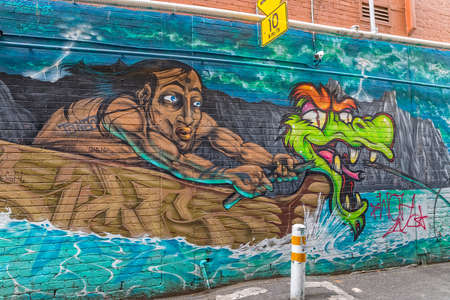 back alley: MELBOURNE, AUSTRALIA - MARCH 16, 2015: Colorful graffiti in back alley of downtown. Editorial