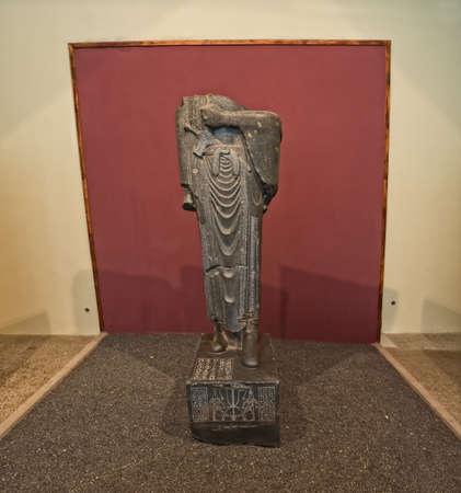 torsos: TEHRAN, IRAN - MAY 1, 2015: Statue of Darius without torsos found in Susa archaeological site excavations and displayed at the National Museum of Iran.