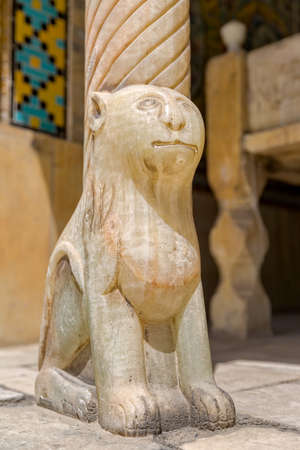 middle east fighting: Lion on marble column base in Golestan Palace former royal Qajar complex in capital city. Tehran, Iran.