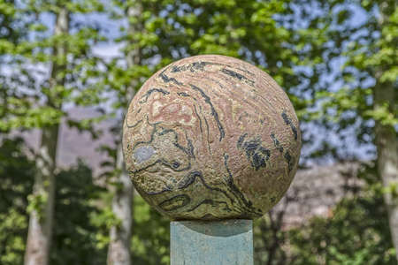 dappled: Dappled stone ball infront of the Green Palace Museum Sabz. Tehran, Iran.
