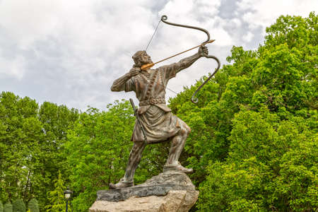 woodland sculpture: Statue of Aresh Kamangir the Archer in the Niavaran Palace Complex garden, is a heroic archer-figure of Iranian oral tradition and folklore. Tehran, Iran.