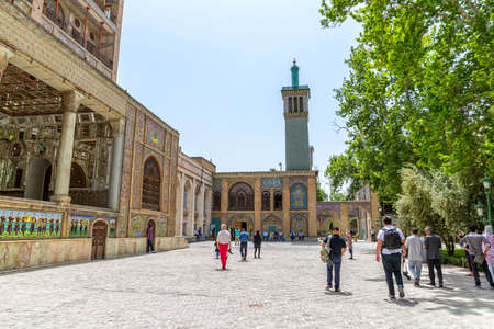 edifice: TEHRAN IRAN  MAY 1 2015:  Visitors walking infront of the Edifice of the Sun and the Windcatchers buildings of royal palace Golestan oldest groups of buildings in persian capital rebuilt to its current form in 1865.