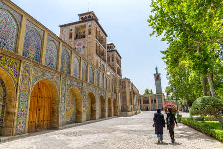 edifice: TEHRAN IRAN  MAY 1 2015: Visitors walking infront of the Edifice of the Sun the royal palace Golestan oldest groups of buildings in persian capital was rebuilt to its current form in 1865. Editorial