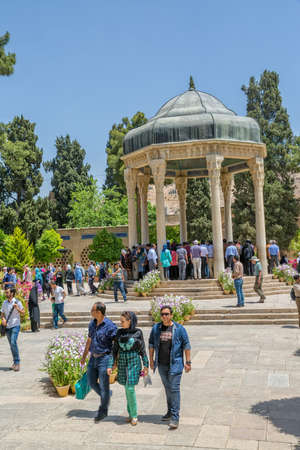 hafez: SHIRAZ, IRAN - MAY 2, 2015: Visitors take a tour of the tomb of Persian poet Hafez. Dome-like structure was erected in Shiraz near his grave at Golgast-e Mosalla in 1452