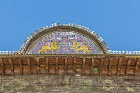 animal private: Zinat ol Molk House roof detail of the lions with the sun, it is a traditional house in old Shiraz city.