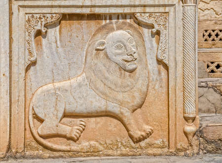 fars: Zinat ol Molk House inner courtyard detail of the lion relief on the marble stone wall. Stock Photo