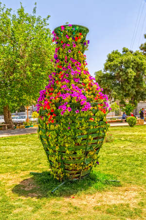 shiraz: Flowers in the park by the old citadel arg of Karmin Khan in the centre of the Shiraz city. Stock Photo