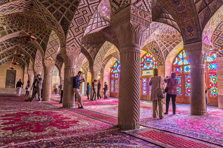 shiraz: SHIRAZ, IRAN - MAY 2, 2015: Visitors take a tour of the beautiful interior of the Nasir Al-Mulk Mosque or Pink Mosque a traditional mosque located in Goad-e-Araban place.