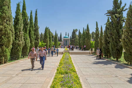 shiraz: SHIRAZ, IRAN - MAY 2, 2015: Visitors take a tour of the mausoleum of Saadi, known also as the tomb of Sady or Sadiyeh.