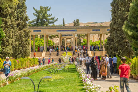 hafez: SHIRAZ, IRAN - MAY 2, 2015: Visitors take a tour of the mausoleum of Hafez